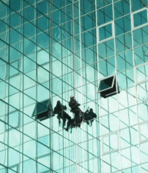 Abseiling reflective glass building