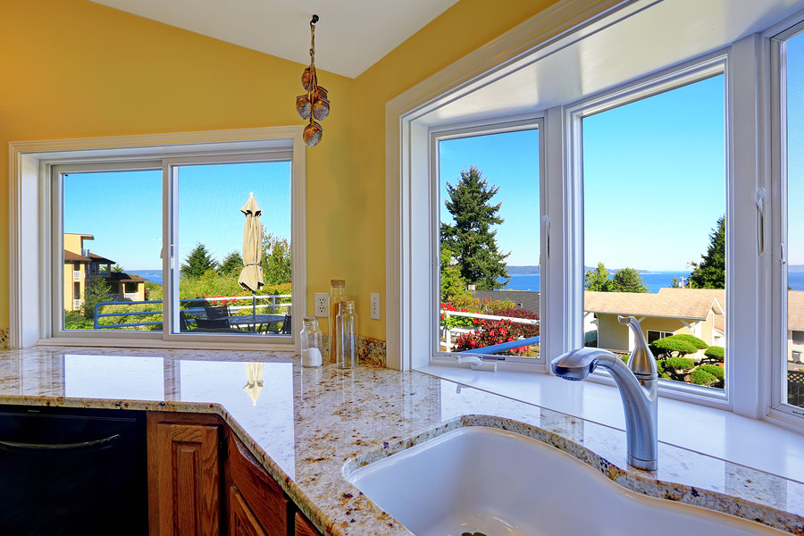 Kitchen Cabinet With Granite Tops And Beautiful Window View