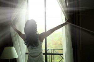 Opening curtains to reveal clean windows