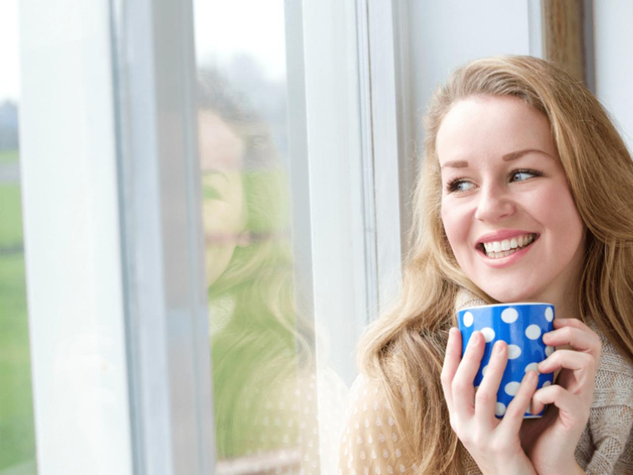 Woman enjoying clean windows