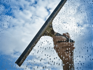 window cleaning with squeegee